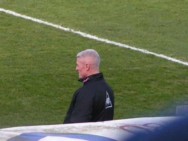 Graham Kavanagh keeps an eye on Carlisle